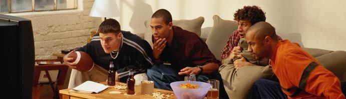 Millennial men watching football